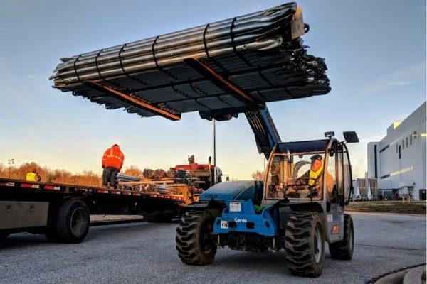 Forklift with Quest Renewables solar carport materials.