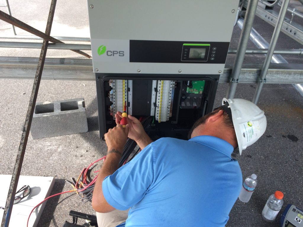 Inverter assembly during construction of Quest Renewables QuadPod solar canopy