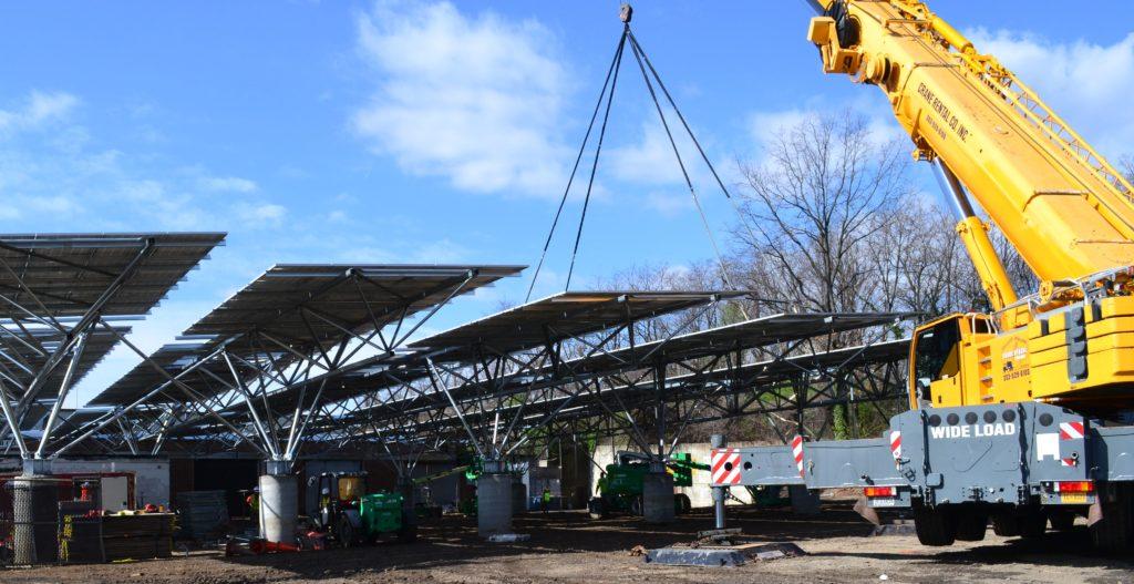 QuadPod long span solar carports construction photo